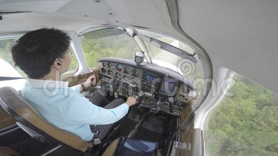 Small plane landing from cockpit stock video footage