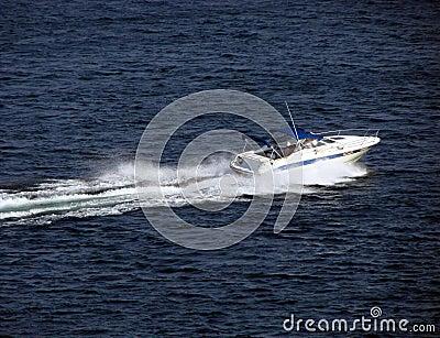 Small Pleasure Boat Craft Speeding on Water
