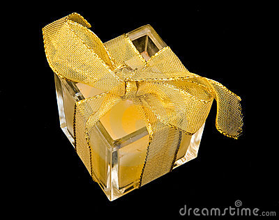 Small present but wrapped with gold ribbon.