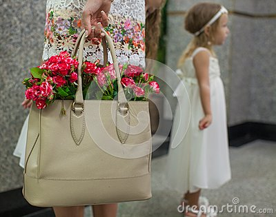 Small red charming roses in fashion women s bag in