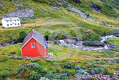 A small red house in village in Norway