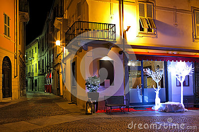 Small restaurant on the corner at night in Italy.