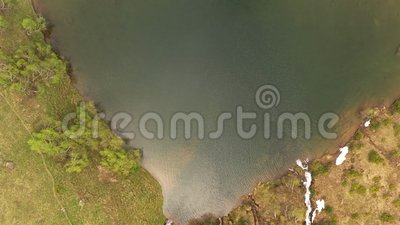 Tourist attraction beautiful lake love in mountains. Aerial takeoff top view. Small ripples on calm water surface. Rapid mountain streams flow into mysterious stock video