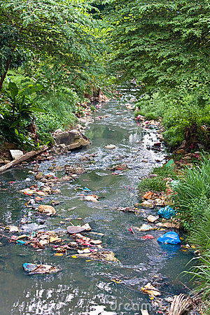 Free Small River Polluted With Garbage Stock Photography - 6114182