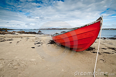 Small rowboat lying at shore