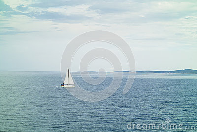 A small sailing yacht in the sea