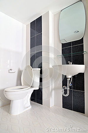 nice small simple bathroom with sink and toilet