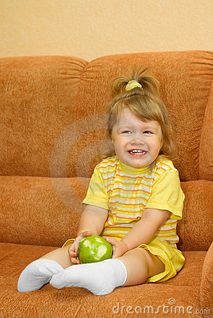 Small smiling girl with green apple