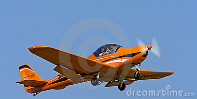 Small sports plane when performing aerobatics Editorial Photography