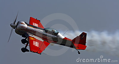 Small sports plane when performing aerobatics Editorial Photo
