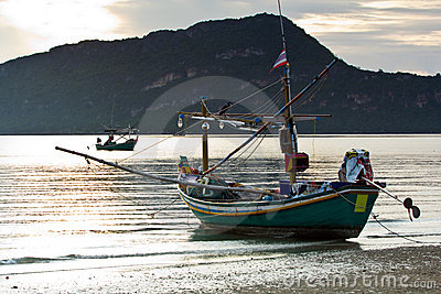 Small squid fishing boat at pranburi beach in the