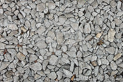 Small stones on a ground with sand for background, design