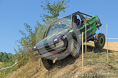 Small suv car at difficult terrain Editorial Photo