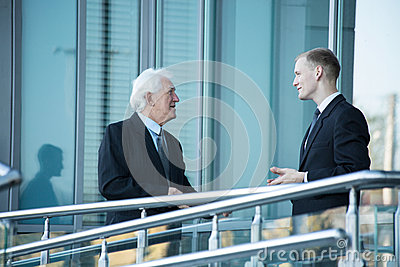 Small talk outside the business centre Stock Photo