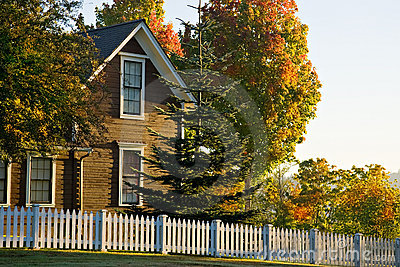 Small town home white picket fence