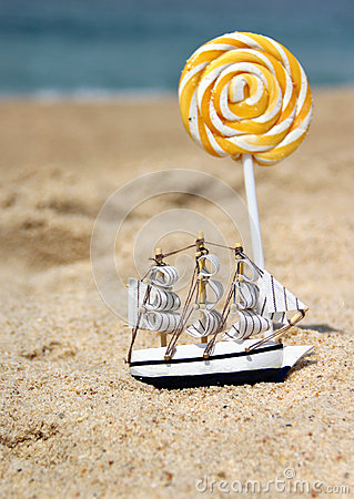 Small toy sailing ship on the beach
