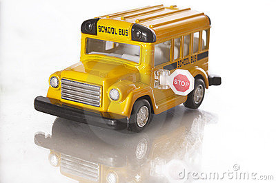 A small toy school bus over white
