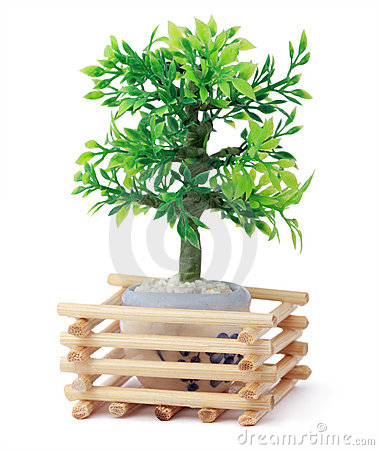 Small toy tree in pot, wooden sticks