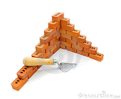 Small trowel and bricks for construction