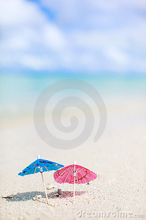 Small umbrellas on tropical beach