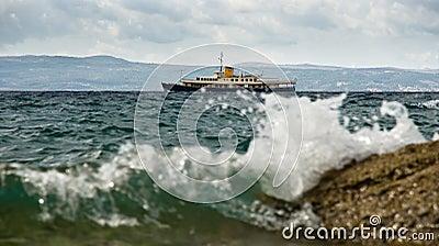 Small vessel in a stormy sea