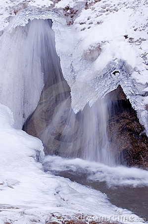 Small Waterfall Flowing Under Ice