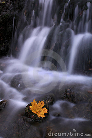 Small waterfall in the forest, late autumn
