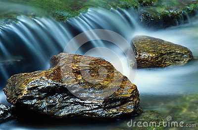 Small waterfall and a pair of river rocks