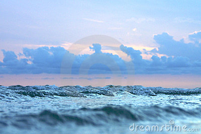 Small waves and stormy sky