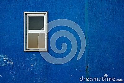 Small window on Blue Wall