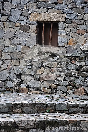 Small window on stone wall