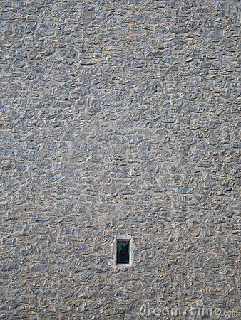 Small window in stone wall