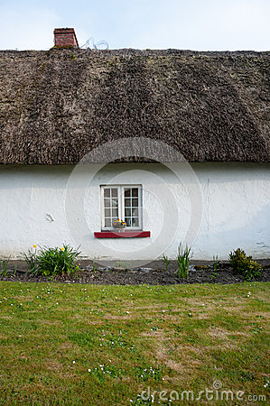 Small Window On Traditional Irish Thatched Cottage Stock