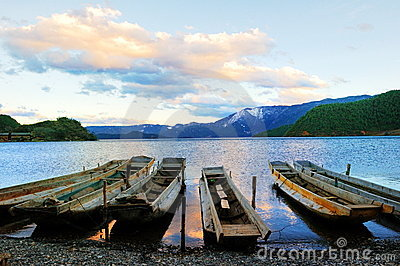 Small wooden boat in the Lugu Lake