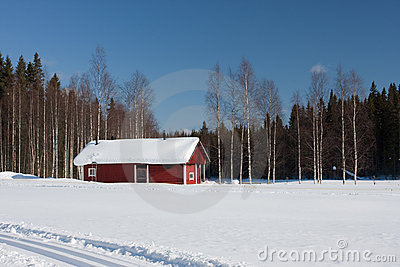 Small wooden house in winter.
