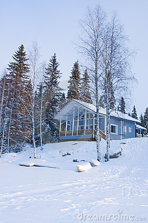 Small wooden house in winter forest