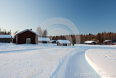 Small wooden houses in winter.