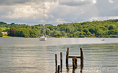 Small yacht and wooden posts on Windermere
