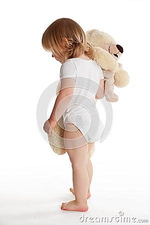 Small young girl hugging Teddybear