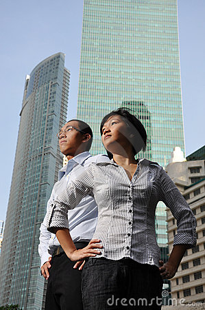 Smart Asian Couple with Office Building