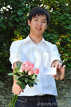 Smart Asian Man Holding A Bouquet Of Flowers