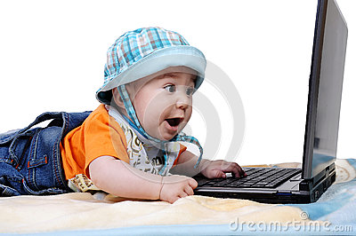 Smart baby is working on laptop