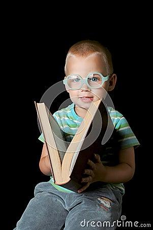 Smart boy closing book