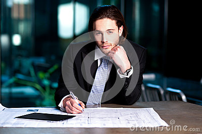 Smart businessman projecting his plans