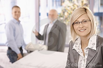 Smart businesswoman in office with coworkers
