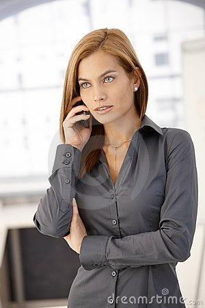Smart businesswoman on phone