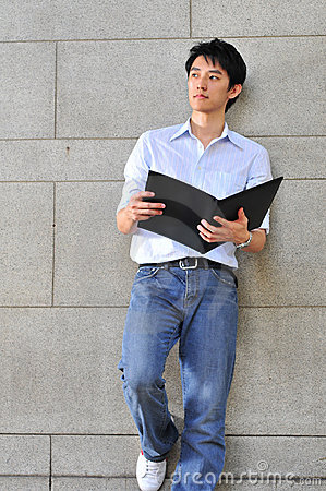 Smart Casual Looking Asian Man Reading