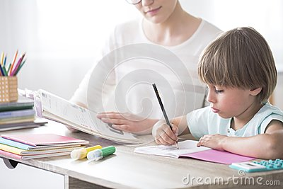 Smart child doing homework Stock Photo