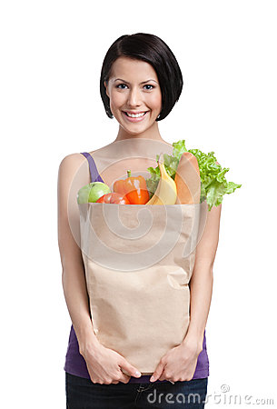 Free Smart Girl With The Packet Of Fruit And Vegetables Royalty Free Stock Images - 26101569