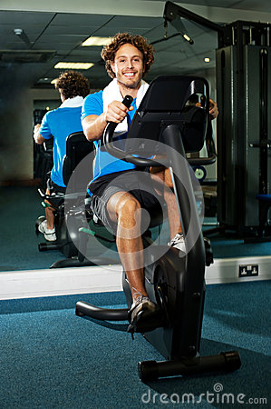 Smart guy working out in the exercise bike